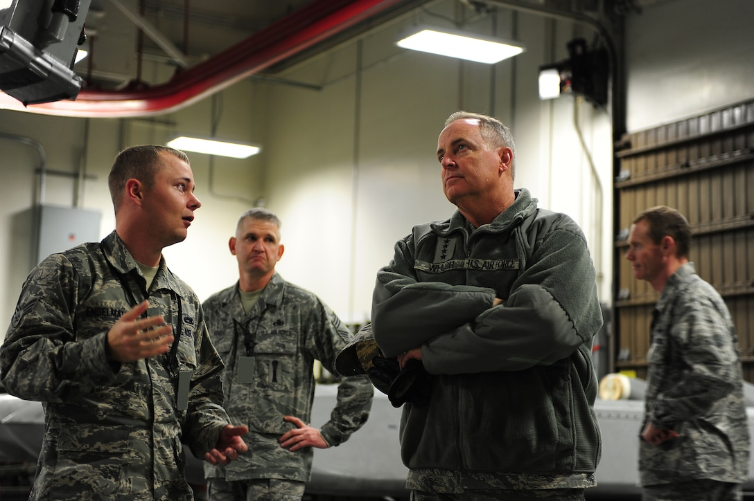 MINOT AIR FORCE BASE, N.D. -- Air Force Chief of Staff Gen. Mark A. Welsh III talks with Airmen from Team Minot during a tour of the Weapons Storage Area here, Nov. 21. The tour was part of Welsh's first visit to Minot since becoming the chief of staff. (U.S. Air Force photo/Airman 1st Class Kristoffer Kaubisch)