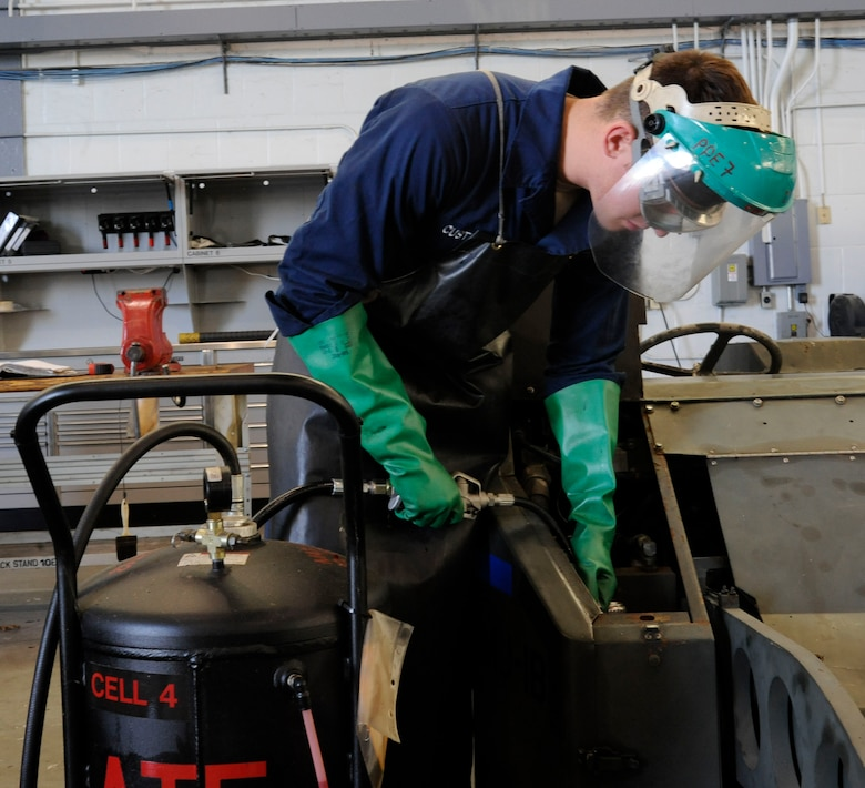 Senior Airman Michael Custodio, 707th Maintenance Squadron, refills hydraulic fluid on a bomb lift on Barksdale Air Force Base, La., Nov. 19. These lifts are one of the most common items the maintenance section works on, and are one of the most vital as they are used to transport and help secure bombs to hard points on the B-52H Stratofortress. (U.S. Air Force photo/Airman 1st Class Andrew Moua)(RELEASED)