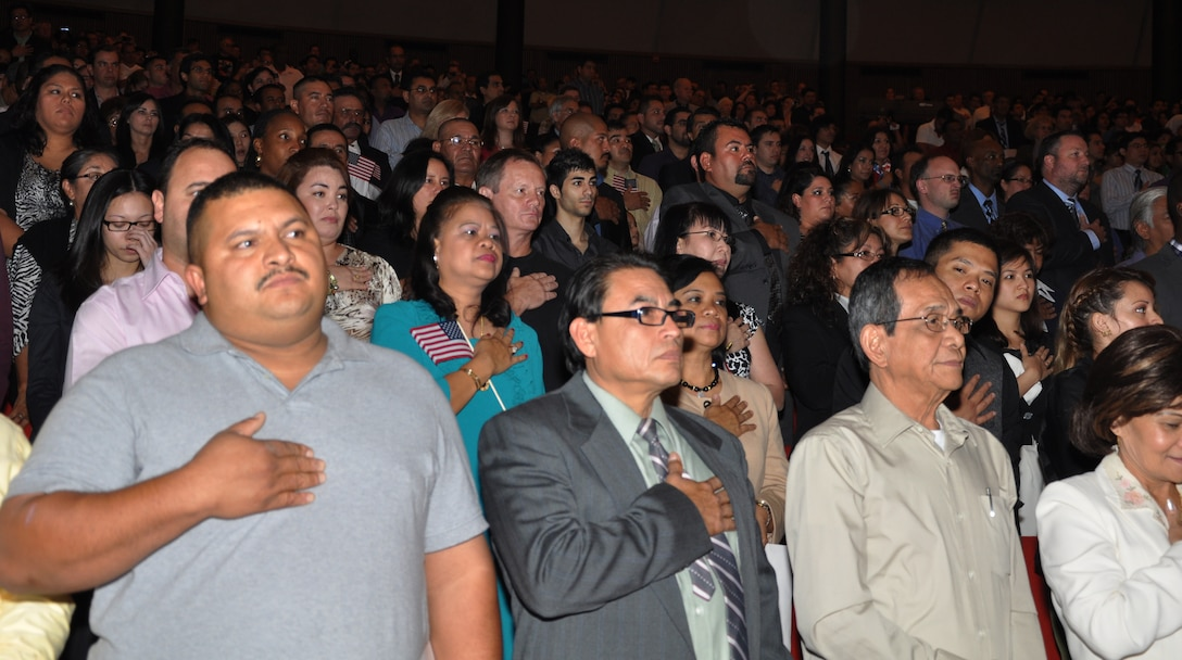 SAN ANTONIO, Texas – New U.S. citizens recite the Pledge of Allegiance Nov. 20 at a U.S. naturalization and citizenship ceremony at Trinity University's Laurie Auditorium here. As the guest of honor, Gen. Edward A. Rice Jr., commander of Air Education and Training Command, addressed the 885 new citizens to welcome and encourage them to get the most out of the opportunity citizenship can bring. (U.S. Air Force photo/Dianne Moffett)