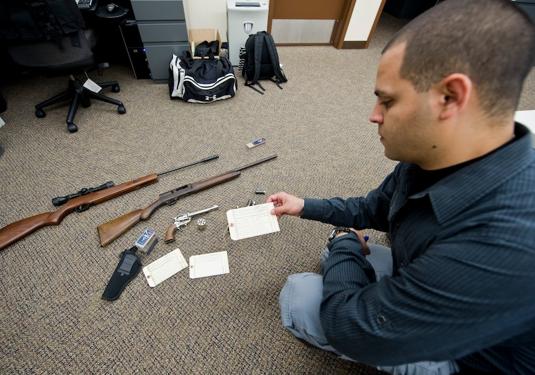 Staff Sgt. Andres Posada, 2nd Security Forces Squadron investigator, inventories evidence confiscated from a crime scene on Barksdale Air Force Base, La., Nov. 20. The investigations flight is responsible for the accountability of all evidence collected in Barksdale's jurisdiction. (U.S. Air Force photo/Staff Sgt. Chad Warren)(RELEASED)