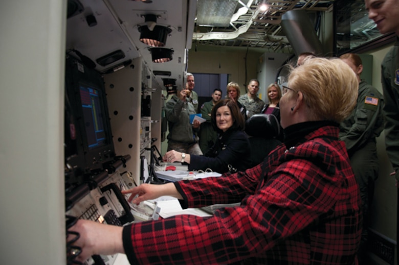 "Betty Welsh, wife of Air Force Chief of Staff Gen. Mark A. Welsh III, and Paula Roy, wife of Chief Master Sgt. of the Air Force James Roy, prepare to ""turn keys"" inside Warren's Missile Procedures Trainer during their visit to F. E. Warren Air Force Base, Wyo., Nov. 19. (U.S. Air Force photo by Airman 1st Class Jason Wiese)"