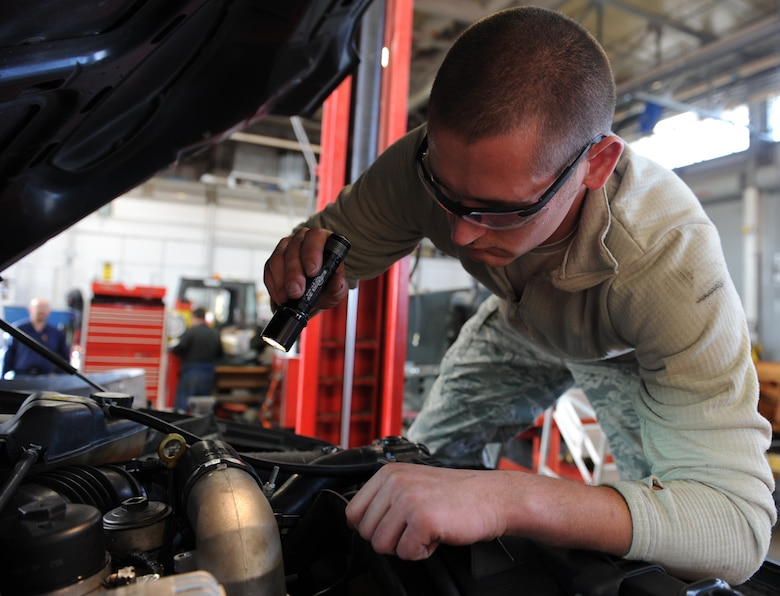 WHITEMAN AIR FORCE BASE, Mo. -- Senior Airman Eduardo Swizer, 509th Logistics Readiness Squadron vehicle mechanic, troubleshoots a wiring harness during a vehicle inspection, Nov. 2. The vehicle maintenance shop performs major maintenance to include transmissions overhauls, engines overhauls and power trains overhauls. (U.S. Air Force photo/Airman 1st Class Bryan Crane) (Released)