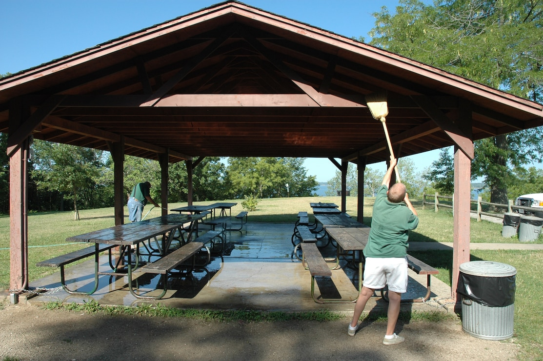 Volunteer cleaning picnic shelter