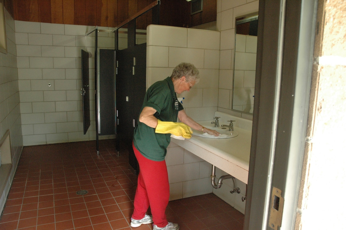 Volunteer cleaning restroom
