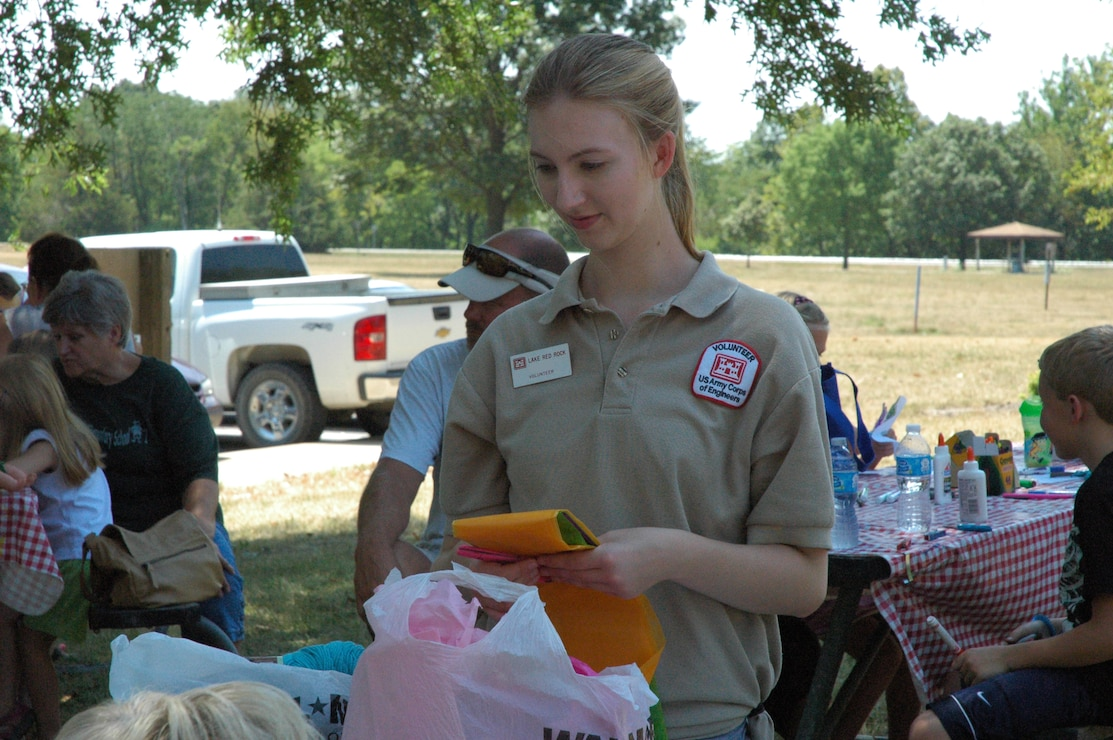 Volunteer assisting with program