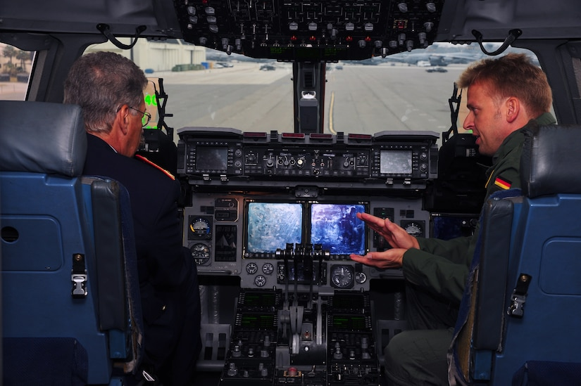 Brig. Gen. Hasso Koertge (left), commander of the German Armed Forces for United States and Canada, speaks with Maj. Sebastian Demitz, a German exchange pilot with the 14th Airlift Squadron, 437th Airlift Wing Nov. 20, 2012, at Joint Base Charleston – Air Base, S.C. Koertge was in Charleston to observe the interaction of Demitz with his U.S. Air Force counterparts, and how he was being utilized on missions. (U.S. Air Force photo/ Airman 1st Class Chacarra Walker)