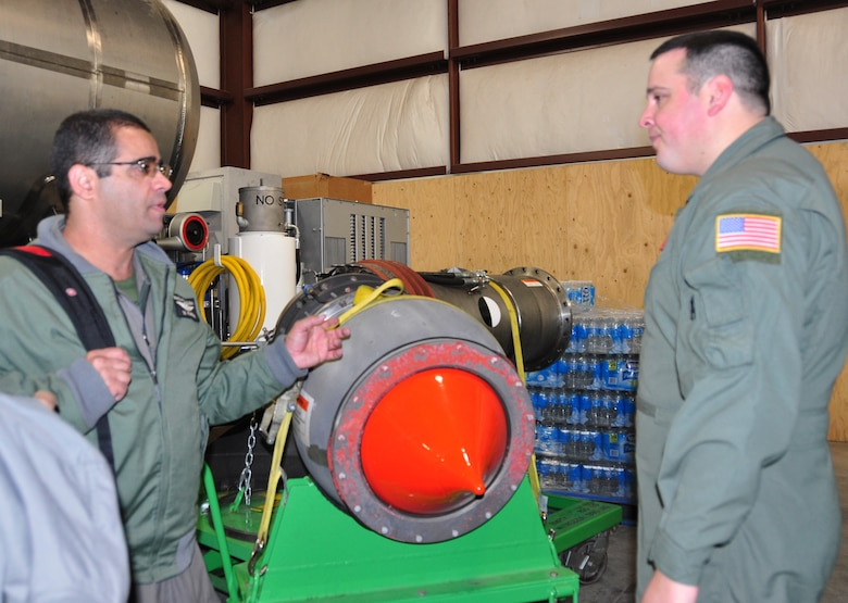 Brazilian Air Force C-130 loadmaster, Master Sgt. Rodrigo Pardini (left) asks Master Sgt. Jason Harvey, 302nd Airlift Wing MAFFS-qualified C-130 loadmaster questions about delivery coverage levels the Modular Airborne Fire Fighting System II nozzle can deliver. Pardini and three members of the Brazilian Air Force's 1st Group Troop Transport visited the Air Force Reserve Command's 302nd AW at Peterson Air Force Base, Colo., Nov. 15, 2012 to learn more about the 302nd AW's MAFFS program and more specifically, the Air Force Reserve unit's conversion from the MAFFS legacy system to the MAFFS II system.  The five-day visit included classroom instruction, open dialogue between the two countries' MAFFS subject matter experts and hands-on tours of the U.S. Forest Service MAFFS II units. The Brazilian Air Force plans to transition to the MAFFS II system in the near future. (U.S. Air Force photo/Ann Skarban)