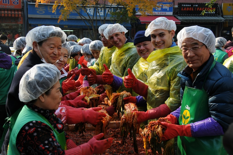 FED volunteers make kimchi with Jung-gu District Mayor Choi Chang-sik Nov. 22.  Members of FED volunteered to help make kimchi for local charities as part of the Good Neighbor Program.