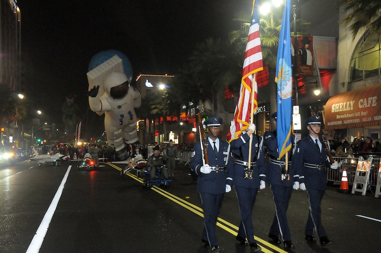 An Air Force honor guard from March Reserve Base heads up the Air Force members participating in the 81st annual Hollywood Christmas Parade, Nov. 25. (Photo by Joe Juarez)