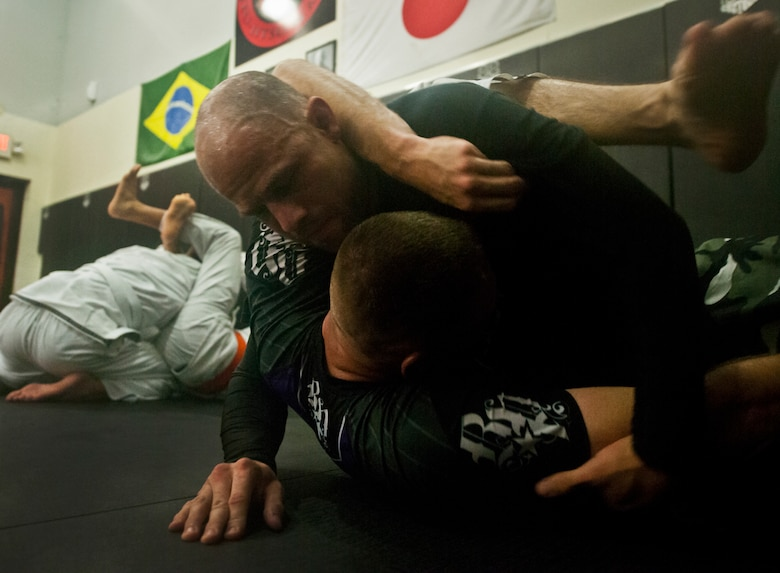 Staff Sgt. Danny Ruiz, a Reservist with the 919th Logistics Readiness Squadron, works on grappling techniques with other mixed martial arts fighters in preparation for Strike Fight, Eglin Air Force Base's first-ever mixed martial arts event Dec. 8.  Ruiz returns to fight at the base where he was stationed as a weapons loader while in the active-duty Air Force.  (U.S. Air Force photo/Tech. Sgt. Samuel King Jr.)