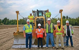 Pictured left to right, James Coffey, president, Harold Coffey Construction; Regina Kuykendoll Cash; Ben Coffey; Donny Davidson, Area Engineer, USACE Caruthersville Area Office; and Bobby Joe George. Second row is USACE Construction Inspector Bobby Carlyle, left, and Johnny Tindle, dozier operator, on right.