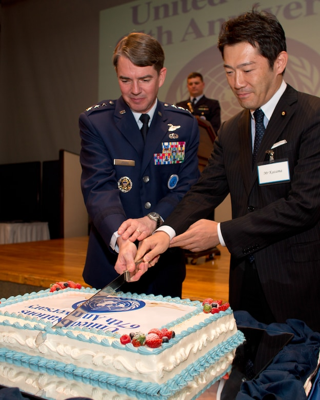 TOKYO, Japan -- (left to right) U.S. Air Force Lt. Gen. Jan-Marc Jouas, United Nations Command Korea, deputy commander, U.S. Forces Korea, deputy commander, Air Component Command, Republic of Korea/U.S. Combined Forces Command, commander, 7th Air Force, commander, and Naoki Kazama, Vice-Minister for Foreign Affairs of Japan, cut the ceremonial cake to commemorate the 67th Anniversary of the United Nations, Nov. 29, 2012 at New Sanno Hotel. (U.S. Air Force photo by Osakabe Yasuo)