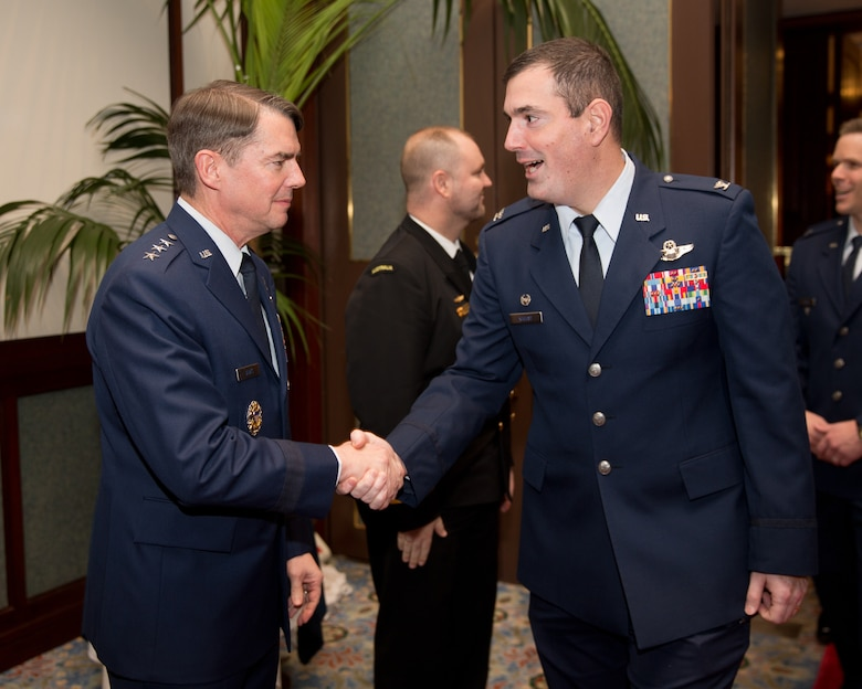 TOKYO, Japan -- (from left to right) U.S. Air Force Lt. Gen. Jan-Marc Jouas, United Nations Command Korea, deputy commander, U.S. Forces Korea, deputy commander, Air Component Command, Republic of Korea/U.S. Combined Forces Command, commander, 7th Air Force, commander, greets U.S. Air Force Col. Mark August, 374th Airlift Wing commander, during the 67th Anniversary of the United Nations, Nov. 29, 2012 at New Sanno Hotel. The United Nations Command was established by UN Security Council Resolution 84 on July 7, 1950 in Tokyo. The command continues to support the Korean Armistice Agreement which was signed July 27, 1953, ending open hostilities. (U.S. Air Force photo by Osakabe Yasuo)