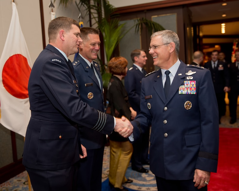TOKYO, Japan -- (from left to right) Royal Australian Air Force Group Captain Luke Stoodley, United Nations Command (Rear) commander, greets U.S. Air Force Lt. Gen. Sam Angelella, U.S. Forces, Japan and 5th Air Force commander, during the 67th Anniversary of the United Nations, Nov. 29, 2012 at New Sanno Hotel. The United Nations Command (Rear) provides liaison and maintains a special UN Forces - Government of Japan Status of Forces Agreement which enables forces of UN member nations to use seven U.S. installations in Japan as UNC supporting facilities in the event of a resumption of hostilities. (U.S. Air Force photo by Osakabe Yasuo)