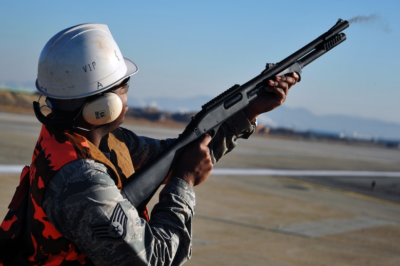 Staff Sgt. Jerron Johnson, 51st Operations Support Squadron airfield management operations supervisor, uses a 12-gauge shotgun to fire off a bird dispersion round on the Osan Air Base flight line, Nov. 27, 2012. The rounds are used to scare birds away from the flight line, limiting possible aircraft mishaps. (U.S. Air Force photo/Staff Sgt. Craig Cisek)