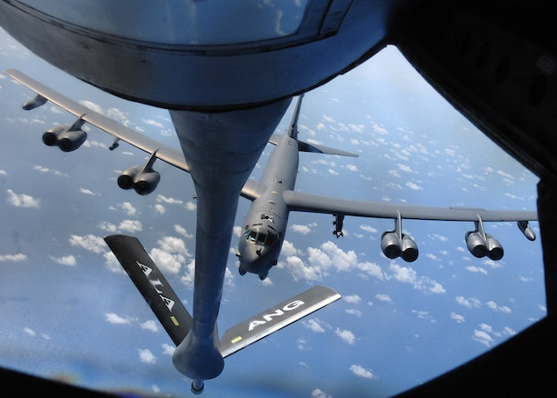 Andersen AFB, Guam --A B-52 Stratofortress bomber from the 96th Expeditionary Bomb Squadron approaches a KC-135 Stratotanker during a practice aerial refueling mission near the Mariana Islands on March 19th. In-flight refueling allows the B-52 to stay airborne longer demonstrating U.S. global reach and global power. The KC-135 is from the 106th Air Refueling Squadron and the 96th EBS is deployed here from Barksdale AFB, La. (U.S. Air Force Photo By Staff Sgt. Vanessa Valentine)