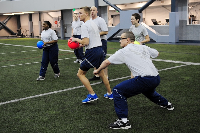 Members of the 354th Operations Support Squadron prepare to launch dodgeballs during Sports Day Nov. 21, 2012, Eielson Air Force Base, Alaska. Sports Day was designed to improve teamwork, boost morale and help increase the awareness of fitness and sports. (U.S. Air Force photo/Staff Sgt. Jim Araos)