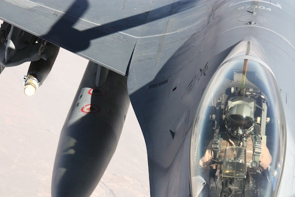 A 117th Air Refueling Wing KC-135 Stratotanker refuels a 113th Fighter Wing F-16 Fighting Falcon over Afghanistan Nov. 18. The F-16 is a compact, multi-role fighter aircraft. It is highly maneuverable and is proven in air-to-air combat and air-to-surface attack. (U.S. Air Force photo/Capt. Andrew Hardy)