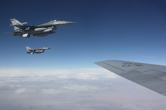 A pair of F-16 Fighting Falcons from the D.C. Air National Guard's 113th Fighter Wing approach a KC-135 Stratotanker from the 117th Air Refueling Wing for refueling over Afghanistan Nov. 18, 2011. Since Sept. 11, 2001 the F-16 has been a major component of the combat forces committed to Operation Enduring Freedom. (U.S. Air Force photo/Capt. Andrew Hardy)