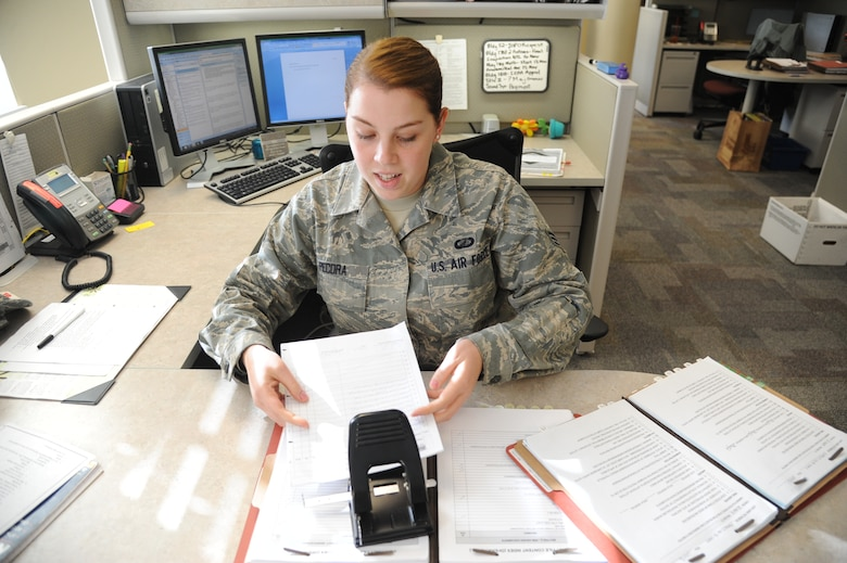 """Senior Airman Laura Pecora, 375th Contracting Squadron. """"I support the mission by acquiring needed supplies in support of all base operations, and by ensuring the facilities are maintained to improve quality of life for base personnel."""" (U.S. Air Force photo/Senior Airman Tristin English)"""