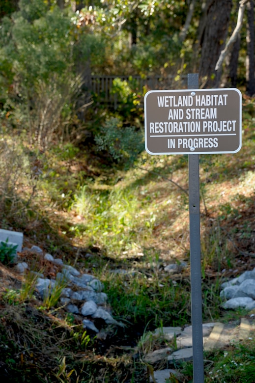 A sign is posted to indicate the Hurlburt Field Youth Center Wetland Stream Project, at Hurlburt Field, Fla., Nov. 28, 2012.  The purpose of the ongoing project is to restore streams to strengthen the ecosystem for plants and wildlife, and in turn, yield educational, volunteer and recreational activities for children and Airmen of Hurlburt Field.  (U.S. Air Force Photo / Airman 1st Class Benjamin D. Kim)