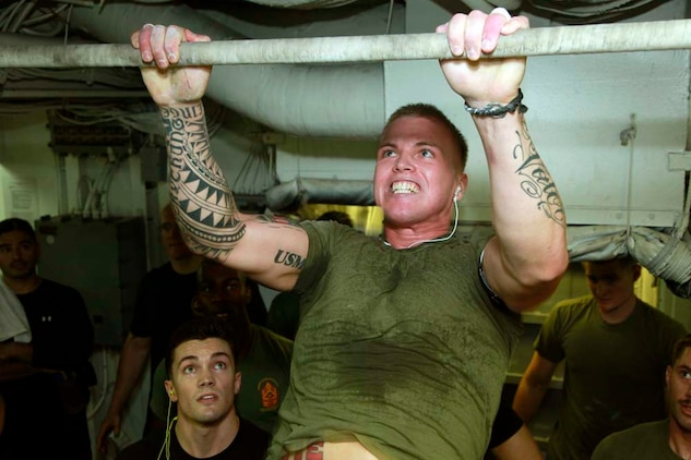 Lance Cpl. Matt J. Mistretta, team leader, 1st Squad, 3rd Platoon, Kilo Company, Battalion Landing Team 3/5, 15th Marine Expeditionary Unit, pulls himself up during the Campbell Cup Pull-Up Challenge in the gym of the USS Peleliu, Nov. 24. Marines and sailors of the 15th Marine Expeditionary Unit and Peleliu Amphibious Ready Group worked in teams of seven to see who could do the most pull-ups in ten minutes.  The 15th MEU is deployed as part of the Peleliu Amphibious Ready Group as a U.S. Central Command theater reserve force, providing support for maritime security operations and theater security cooperation efforts in the U.S. 5th Fleet area of responsibility. Mistretta, 22, is from Reno, Nev. (U.S. Marine Corps photo by Cpl. John Robbart III/Released)