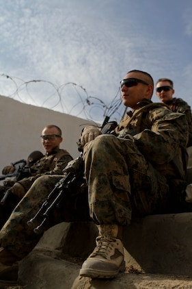 Lance Cpl. Dallin Jaramillo, rifleman, Lima Company, 3rd Battalion, 9th Marine Regiment, Regimental Combat Team 7, takes a break at an Afghan Local Police station, Nov. 27, 2012. The Marines drank chai tea with the ALP and patrolled with the Afghan National Army.