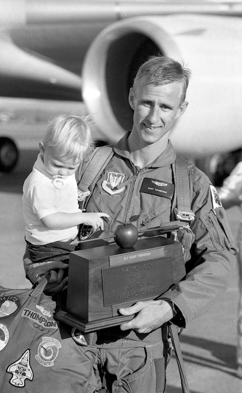 Oregon Air National 1st Lt. Gary Thompson with his son Jason pose for a photograph at the Portland Air National Guard Base, Portland, Ore., in August of 1988, after he has returned from the 1988 William Tell Weapons Meet at Tyndall AFB, Fla. after winning the Top Shooter award.  (photo courtesy of the 142nd Fighter Wing Public Affairs Department)