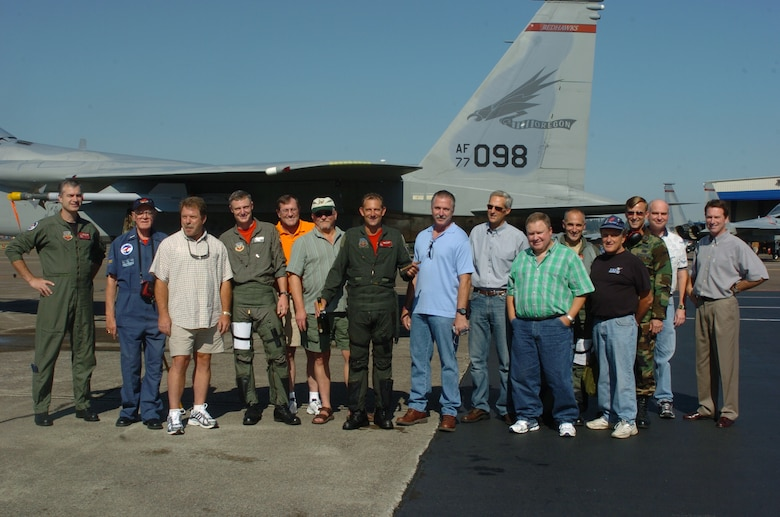 Oregon Air National Lt. Col. Gary Thompson (third from the right) stands with group of family and friends of Lt. Col. (ret.) Dave McKinney (center) after his Fini Flight on Sept. 27, 2006 at the Portland Air National Guard Base, Portland, Ore. McKinney and Thompson won the Top Gun and Top Shooter awards at the 1988 William Tell Weapons meet at Tyndall AFB, Fla. (U.S. Air Force photo by Tech. Sgt. Todd Enlund (ret.) 142nd Fighter Multimedia department / released)