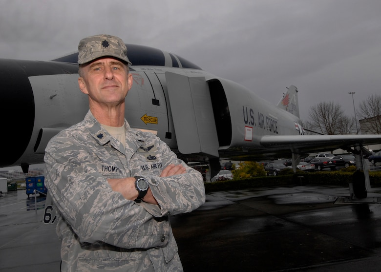 Oregon Air National Lt. Col. Gary Thompson stands in front of the F-4C aircraft on display at the Portland Air National Guard Base, Portland, Ore., on his last day of active, Oct. 31, 2012. Thompson won the top shooter award as a Weapons Systems Officer flying in one of the 142nd Fighter Wing's F-4C models at the 1988 William Tell Weapons meet at Tyndall AFB, Fla. (U.S. Air Force photo by Tech. Sgt. John Hughel, 142nd Fighter Wing Public Affairs / released)