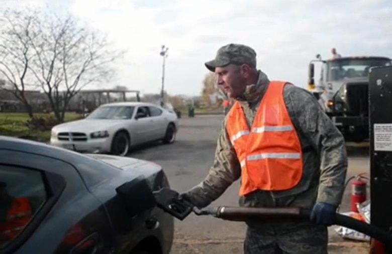 Tech. Sgt. Kevin Cane, an Air National Guardsmen of the 104th Fighter Wing, pumps gasoline for vehicles essential to maintaining New York City's infrastructure at a fuel supply point on Floyd Bennett Field in Brooklyn, N.Y. The operation has distributed over 280,000 gallons of motor vehicle gasoline and more than 78,000 gallons of diesel fuel to emergency vehicles, school busses, and tactical military vehicles used for relief efforts. Hurricane Sandy was the largest Atlantic Hurricane on record and caused the most damage in New York and New Jersey Oct. 29, 2012. (U.S. Navy photo by Mass Communication Specialist 1st Class Julian T. Olivari/Released).