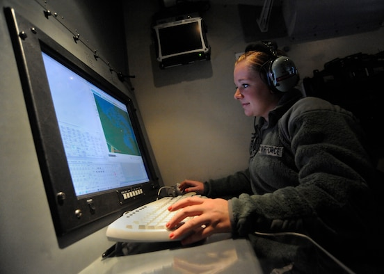 Oregon Air National Guard Senior Airman Brittani Schammen, a 116th surveillance technician, Camp Rilea Ore., is scanning the display screen so she can identify simulated aircraft flying in and around the active air space during a joint training exercise, Sept. 26, 2012.