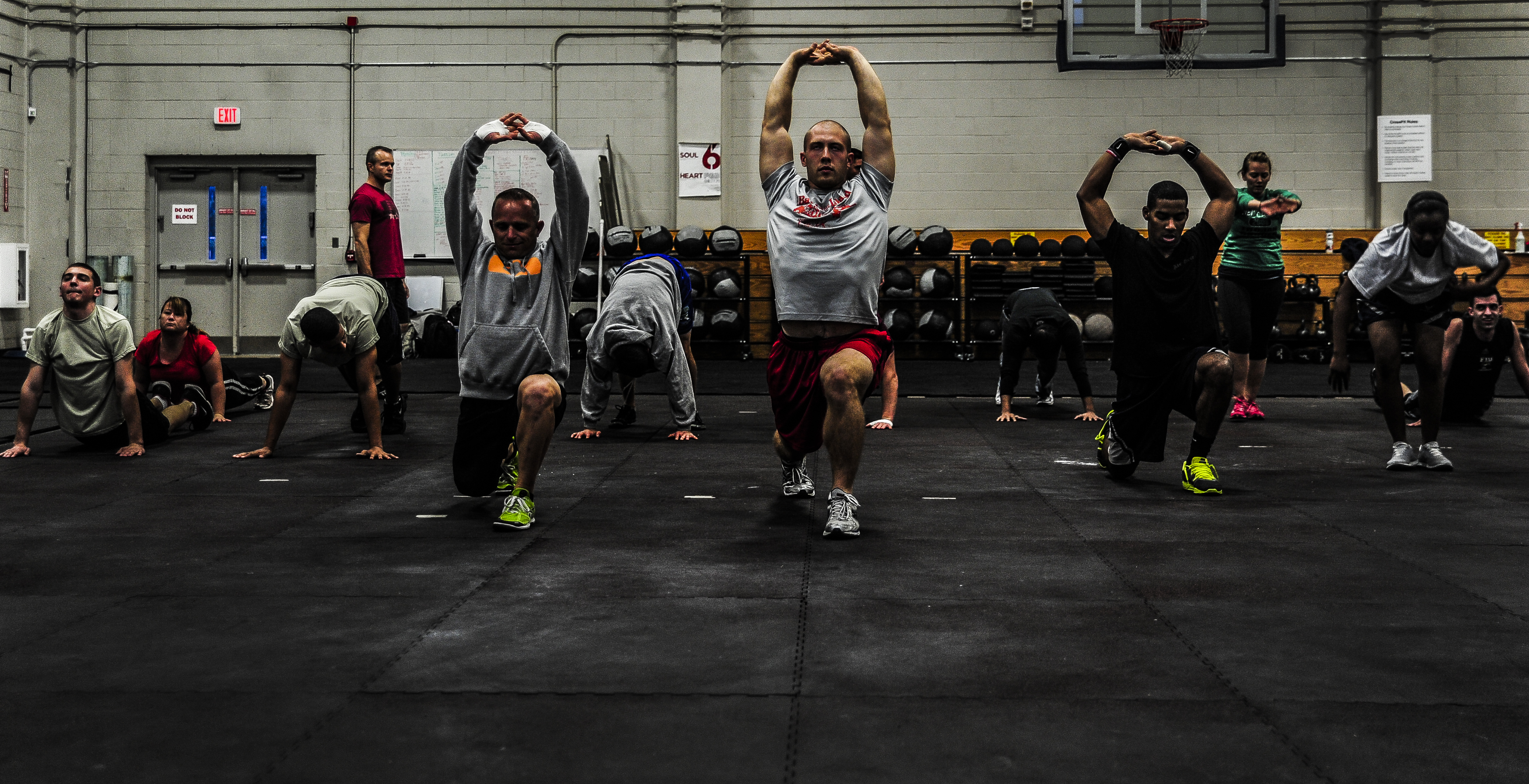 Service Members And Dependents Stretch As A Group Before CrossFit Class Nov 19