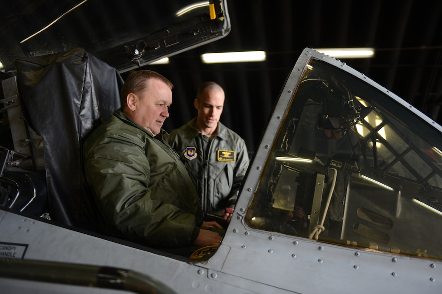 SPANGDAHLEM AIR BASE, Germany – Polish air force Brig. Gen. Wlodzimierz Usarek, left, 2nd Tactical Air Wing commander, studies an A-10 Thunderbolt II cockpit with U.S. Air Force Lt. Col. Clinton Eichelberger, 81st Fighter Squadron commander from Annapolis, Md., on the flightline during a visit to Spangdahlem AB Nov. 27, 2012. Usarek was accompanied by Polish air force Brig. Gen. Tadeusz Mikutel, 1st Tactical Air Wing commander and Col. Kristian Ziec, 32nd Air Base commander during the tour around the base. (U.S. Air Force photo by Airman 1st Class Gustavo Castillo/Released)