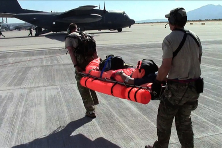 California Air National Guard pararescuemen transfer an injured commercial sailor to an awaiting MC-130P Combat Shadow, Nov. 29, 2012.  Pararescuemen from the 131st Rescue Squadron, Moffett Federal Airfield, Calif. performed the rescue operation 300 miles southwest of the coast of Cabo San Lucas. (photo courtesy by California Air National Guard)
