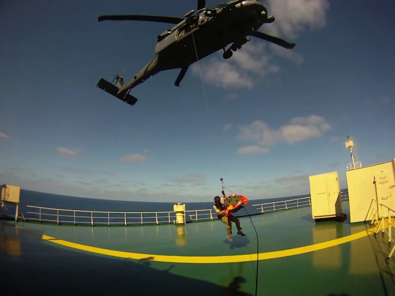 A California Air National Guard pararescueman from the 131st Rescue Squadron, Moffett Federal Airfield, Calif., hoist down to a merchant vessel, Nov. 29, 2012. The pararescuemen rescued an injured commercial sailor 300 miles southwest of the coast of Cabo San Lucas. (photo courtesy by California Air National Guard)