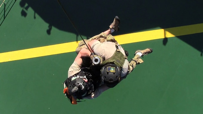 California Air National Guard pararescuemen from the 131st Rescue Squadron hoist down to a merchant vessel, Nov. 29, 2012. The pararescuemen rescued an injured Filipino commercial sailor 300 miles southwest of the coast of Cabo San Lucas. (photo courtesy by California Air National Guard)