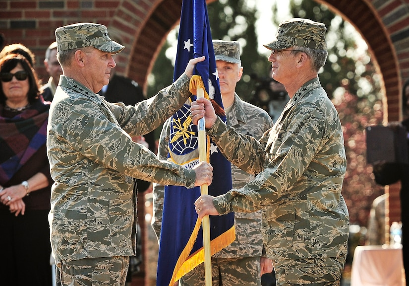 Gen. Paul J. Selva accepts the Air Mobility Command guidon from Gen. Mark A. Welsh III, Chief of staff of the Air Force, during the change of command ceremony at Scott Air Force Base, Ill., Nov. 30, 2012. Selva was previously assigned as the assistant to the Chairman of the Joint Chiefs of Staff in Washington D.C. The outgoing commander, Gen. Raymond E. Johns Jr., served 35 years in the Air Force, commanding more than 130,000 Airmen as well as reaching 4,500 flight hours in various aircraft. (U.S. Air Force photo/Staff Sgt. Ryan Crane)