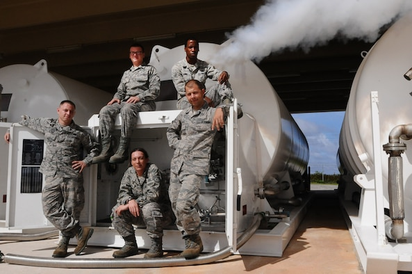 Airmen from the 36th Logistics Readiness Squadron's fuels management cryogenics production element pose in front of a liquid oxygen storage tank here Nov. 29. Unique to a few locations in the Air Force, the team utilizes cryogenic technology to provide pure, clean breathing oxygen and clean, dry nitrogen in support of a multitude of units' aviation, medical and maintenance needs. (U.S. Air Force photo by Senior Airman Carlin Leslie/Released)