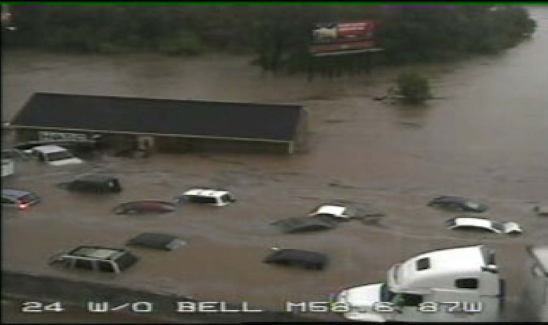 24 West of Bell Road in the Mill Creek basin during the May 2010 flood. The structure seen in the photograph is actually floating down the stream, and is moments from being torn apart and sucked under the I-24 Bridge. (TDOT photo)