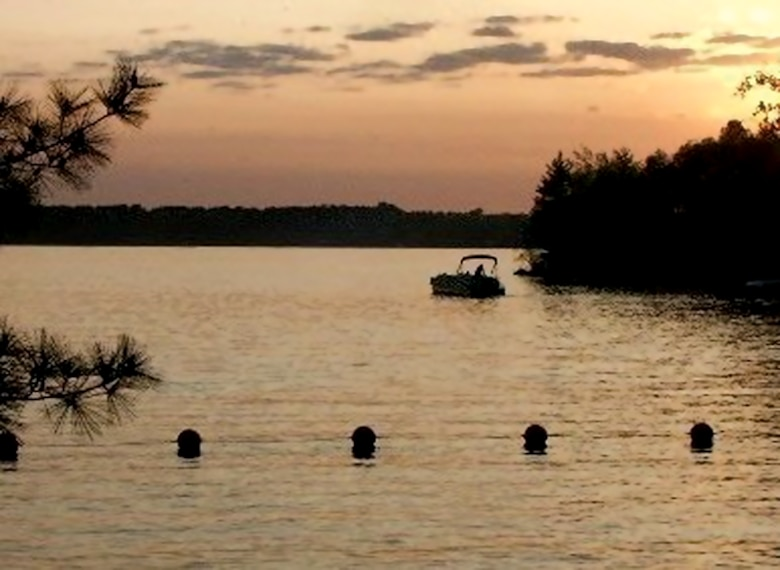 The sun sets behind some boaters on Cross Lake. The St. Paul District operates 49 recreation areas, ranging from public landings along the Mississippi River to lock and dam visitor centers to full-service campgrounds. These recreation areas are an important component of the region's tourism industry, and the impact on the local and regional economies is significant.