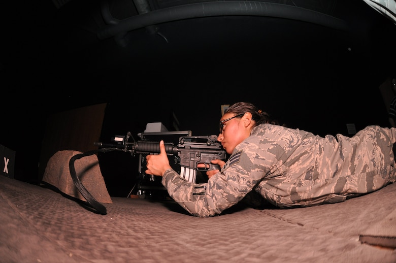Senior Airman Senovia Gallegos a Traditional Reservist with the 477th Security Forces Squadron, trains on the Engagement Skills Trainer 2000 here. The EST 2000 offers a realistic alternative for training in marksmanship, collective and shoot/do not shoot scenarios on both the M-9 and the M-4. The 477th SFS stood up under the 477th FG here March 1. (U.S. Air Force Reserve Photo/Tech. Sgt. Dana Rosso)