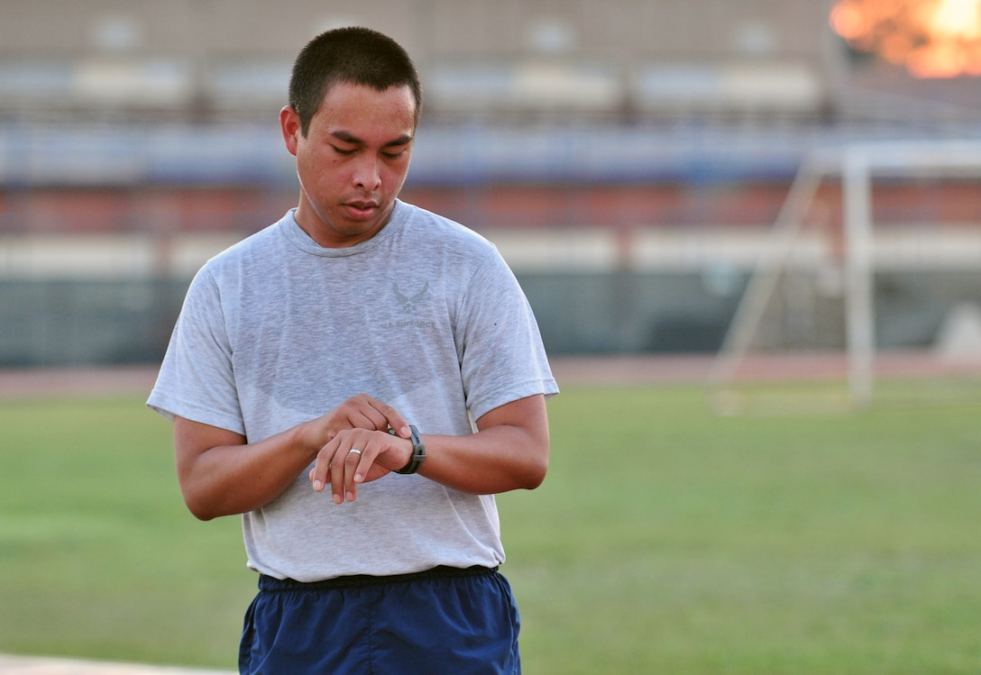 Staff Sgt. Norman Cabrera, 39th Logistics Readiness Squadron, checks his heart rate monitor after completing an interval during the running improvement program Sept. 28, 2012, at Incirlik Air Base, Turkey. The class is designed to help Airmen who  scored lower than 45 points on the cardiovascular portion of their fitness assessment tests improve their run time. (U.S. Air Force photo by Senior Airman Daniel Phelps/ Released)