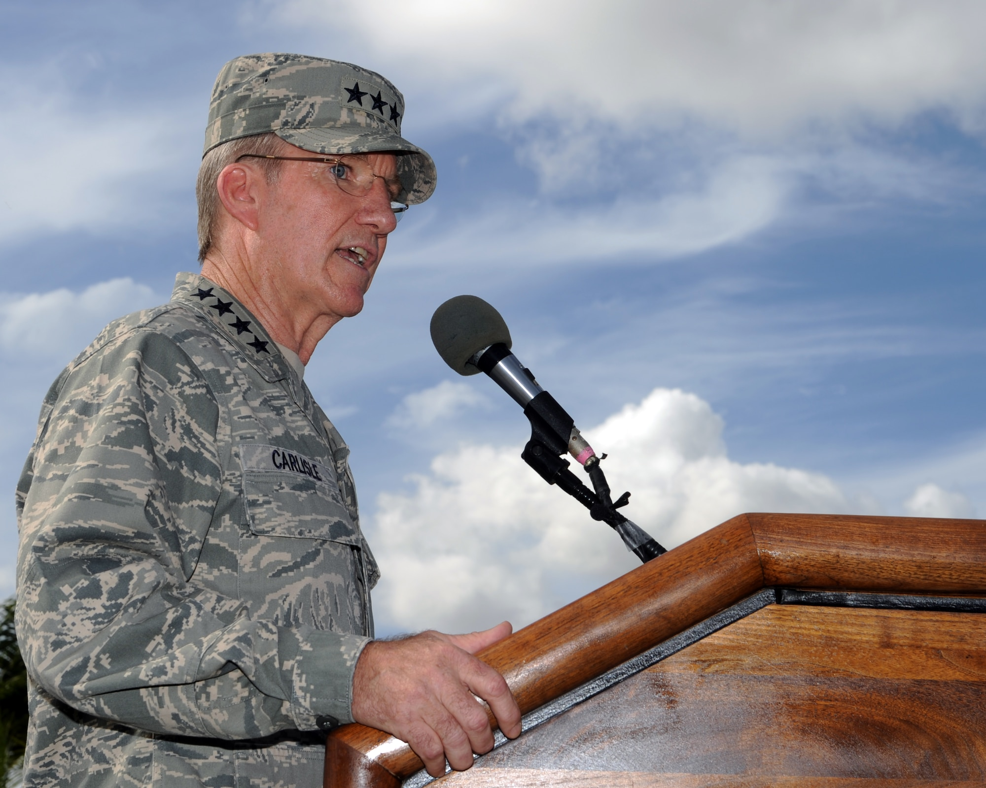"""Gen. Herbert J. """"Hawk"""" Carlisle, Pacific Air Forces commander, delivers a speech during the 13th Air Force inactivation ceremony Sept. 28 at Joint Base Pearl Harbor-Hickam, Hawaii. (U.S. Air Force photo/Staff Sgt. Nathan Allen)"""