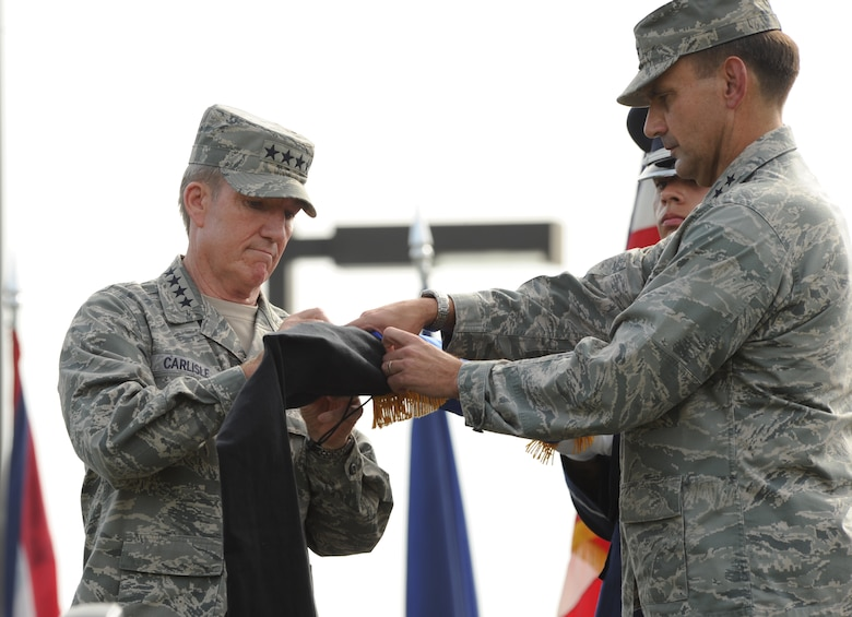 "Gen. Herbert J. ""Hawk"" Carlisle, Pacific Air Forces commander, encases the 13th Air Force flag with Lt. Gen. Stanley T. Kresge, former 13th Air Force commander, during the 13th Air Force inactivation ceremony Sept. 28, 2012, at Joint Base Pearl Harbor-Hickam, Hawaii. The 13th Air Force was inactivated and combined with the staff of Pacific Air Forces at Joint Base Pearl Harbor-Hickam, Hawaii. (U.S. Air Force photo/Tech. Sgt. Matthew McGovern)"