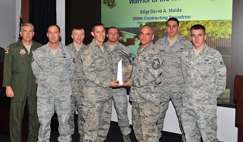 Airmen from the 355th Operations Support Squadron, accept the D. Ray Hardin award for best air traffic control facility in the Air Force. (U.S. Air Force photo by Airman 1st Class Joshua Slavin/Released)