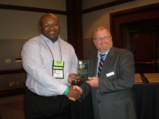 Old Hickory Lake Natural Resource Manager Frederick Bell (left) receives the Award of Merit for the National Water Safety Congress Region 3 Vice President Ernest Lentz March 5, 2012.