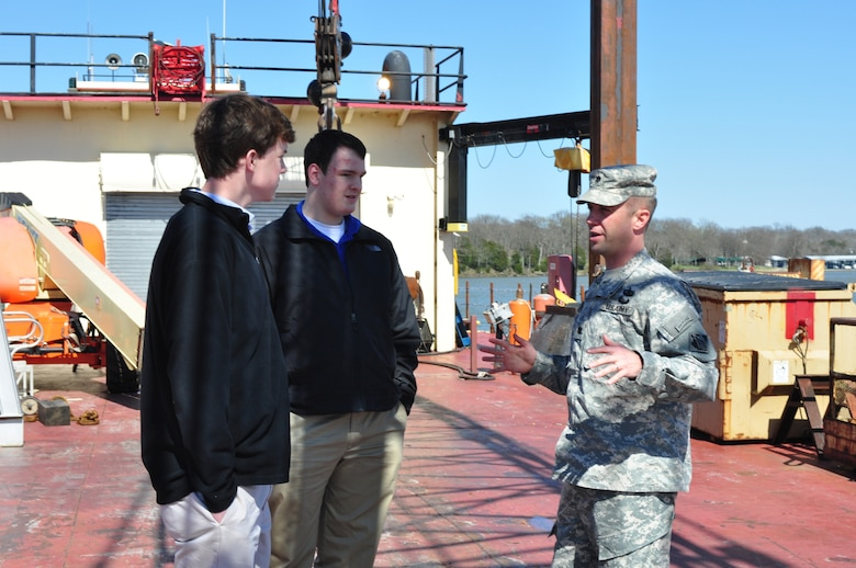 Lt. Col. James A. DeLapp (Right), U.S. Army Corps of Engineers Nashville District commander, shows Montgomery Bell Academy students Will Singer (Left) and D. J. Mott a Corps of Engineer's work barge at Old Hickory Lake March 9, 2012. (USACE photo by Amy Redmond)