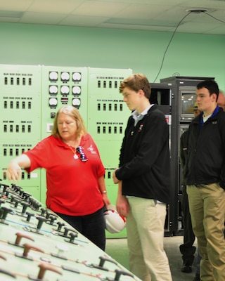 Power Project Operator Olga Beddingfield at Old Hickory Dam explains how the dam and its hydropower is operated and controlled March to MBA students Will Singer (Middle) and D.J. Mott during a project tour March 9, 2012. (USACE photo by Amy Redmond)