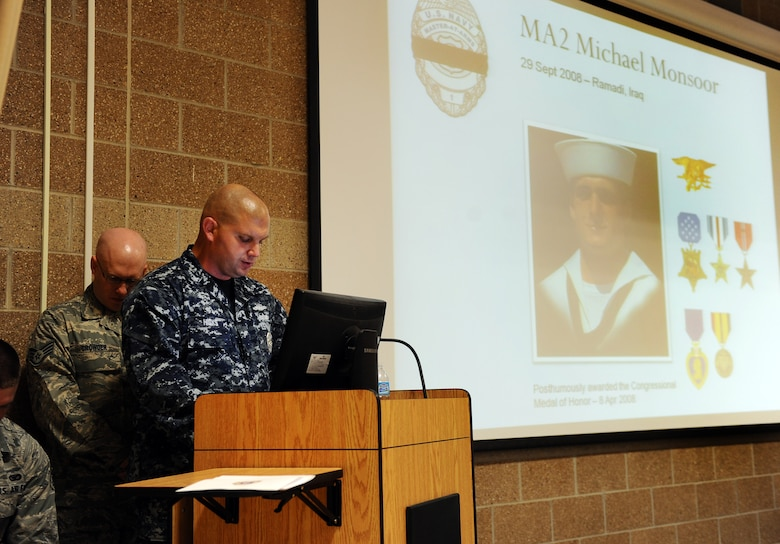 U.S. Navy Master at Arms 1st Class Marc Hicks, 55th Security Forces Naval detachment speaks about Michael Monsoor who died in combat in Ramadi, Iraq, in 2008, at the 2012 Fallen Defenders and Master at Arms dedication ceremony held in the guard mount room of the 55th SFS headquarters building on Offutt Air Force Base, Neb., Sept. 28.  The dedication ceremony is held annually to honor the sacrifices the men and women of the security forces career field have made in support of Operations ENDURING FREEDOM and IRAQI FREEDOM.  (U.S. Air Force photo by Josh Plueger/Released).